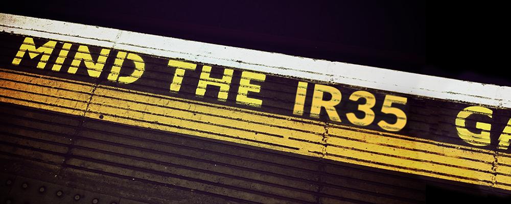 Underground platform painted with 'Mind the IR35'