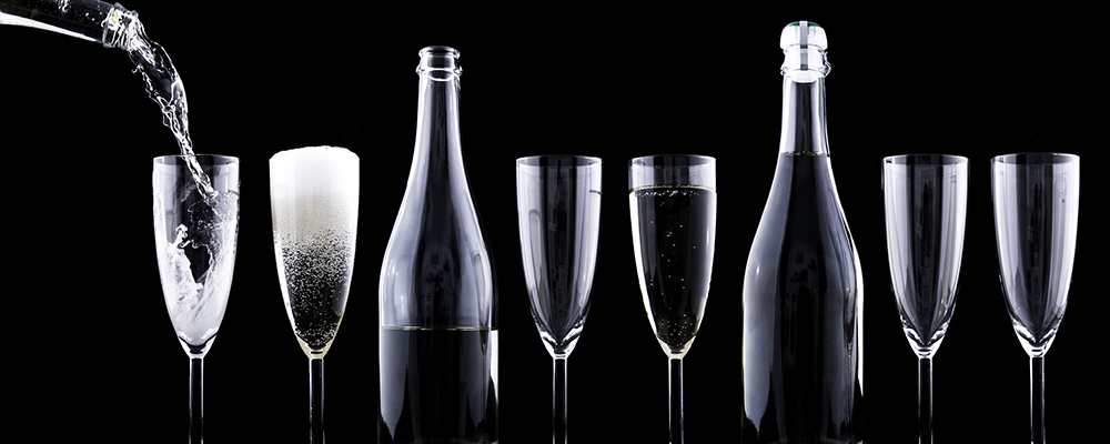 champagne being poured into flute glasses
