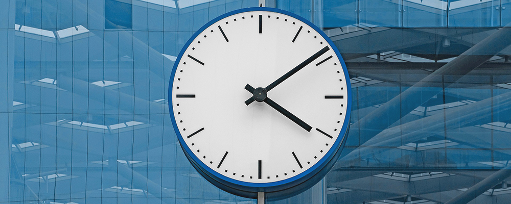 London clock face with blue building background