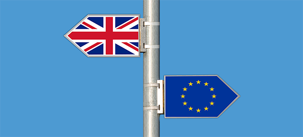 Signpost arrows to UK and EU to represent Brexit