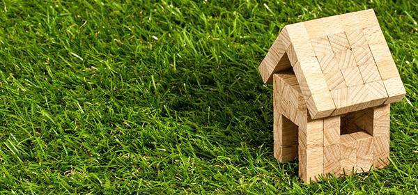 wooden brick house on grass