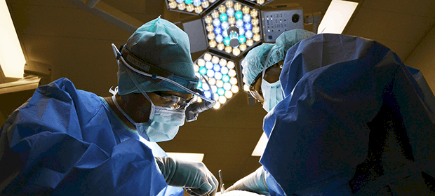 NHS surgeons in an operating room