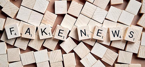 Scrabble tiles sleeping out 'fake news'