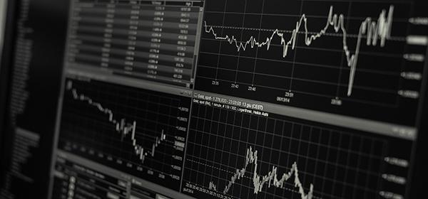 stock market graphs on a computer screen