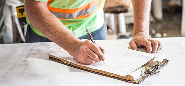 Construction professional completing paperwork