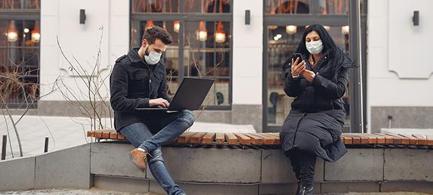 Staff on an outdoor break wearing face masks