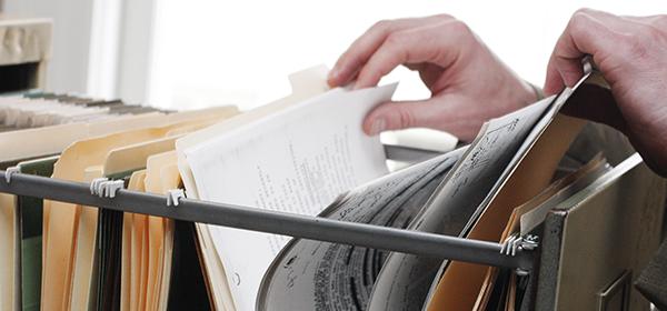 Employer looks through employee files