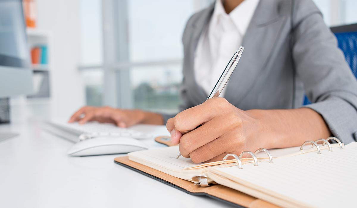 business insurance broker working at a desk